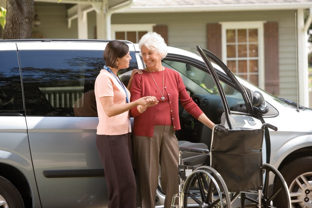 Home care aide providing non-medical travel assistance services for a patient